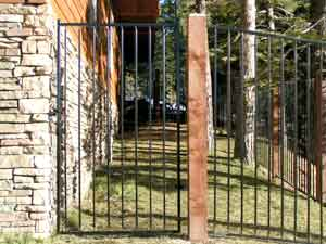 ornamental iron with wood posts