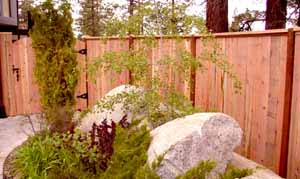 wood fence around landscaping