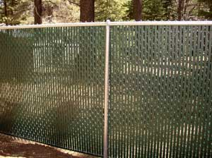 Privacy slats inserted into chain link fence.
