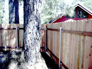 redwood fence with steel posts